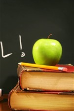 Back to school, books, green apple