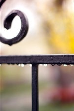 Preview iPhone wallpaper Fence, water droplets, hazy background