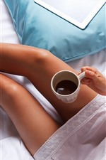 Girl legs, coffee, donut, bed