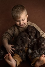Preview iPhone wallpaper Little boy and three puppies