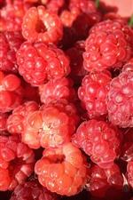 Preview iPhone wallpaper Many ripe raspberries, berries