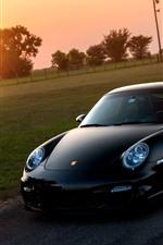 Preview iPhone wallpaper Porsche 911 black supercar at sunset