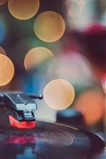 Record player, light circles, hazy