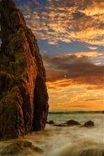 Sea, rocks, sunset, glare, clouds