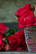 Some red roses, vase, glass cup