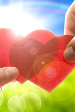 Preview iPhone wallpaper Two red love hearts, hands, sunshine, glare
