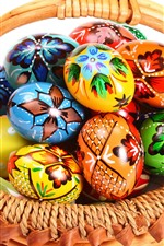 Colorful Easter eggs, basket, white background