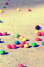 Preview iPhone wallpaper Colorful candy pills, floor