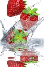 Strawberries, water droplets, splash
