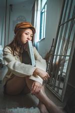 Preview iPhone wallpaper Asian girl, sit on floor, book, look