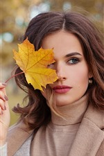 Preview iPhone wallpaper Brown hair girl, yellow leaf