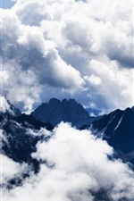 Mountains, white clouds, hazy