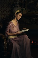 Preview iPhone wallpaper Retro style girl, read book, fireplace, candles, books