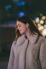Preview iPhone wallpaper Smile girl, coat, night, lights, hazy