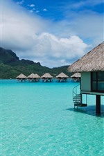 Preview iPhone wallpaper Tropical, bungalows, blue sea, island, clouds