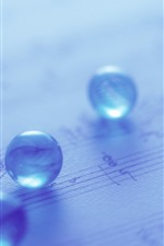 Preview iPhone wallpaper Some glass balls, light blue, hazy