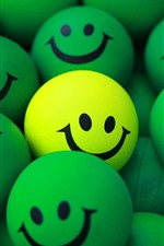 Preview iPhone wallpaper Some green balls, smiley face, one yellow