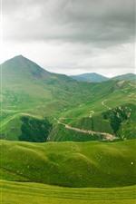 Beautiful green nature landscape, mountains, grass, clouds