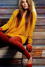 Preview iPhone wallpaper Model girl, brown hair, yellow sweater, pose