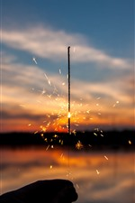 Preview iPhone wallpaper Sparks, gitter, sunset
