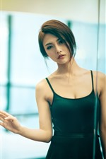 Preview iPhone wallpaper Beautiful Asian girl, look at mirror