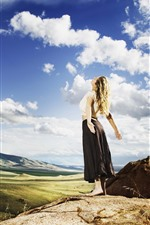 Preview iPhone wallpaper Blonde girl, back view, clouds, mountains, sunshine