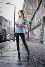 Preview iPhone wallpaper Blonde girl, street, city
