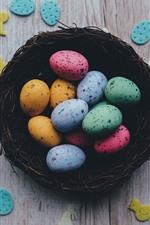 Aperçu iPhone fond d'écranOeufs de Pâques colorés, nid, bureau