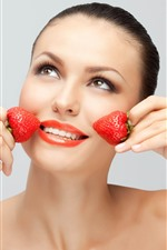 Preview iPhone wallpaper Fashion girl, two strawberries, face, hands, smile