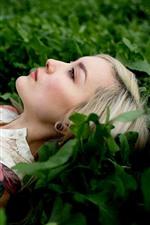 Preview iPhone wallpaper Blonde girl, rest, green grass