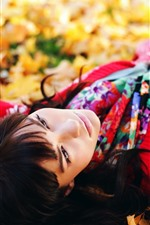 Preview iPhone wallpaper Girl sleep on ground, maple leaves, autumn