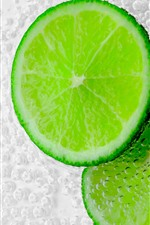 Green lemon slice, bubbles