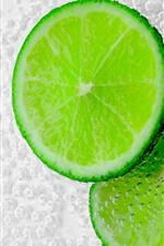Preview iPhone wallpaper Green lemon slice, bubbles