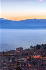 Preview iPhone wallpaper Italy, castle, city, morning, lights, fog