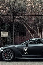 Preview iPhone wallpaper Nissan GT-R black supercar side view, wire fence