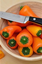 Preview iPhone wallpaper Orange peppers, bowl, knife