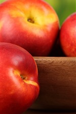 Preview iPhone wallpaper Red peaches, bowl