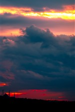 Preview iPhone wallpaper Sunset, thick clouds, towers, night