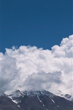 Thick white clouds, mountains, sky