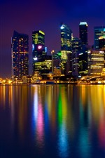 Beautiful city night view, Singapore, colorful lights, skyscrapers, sea