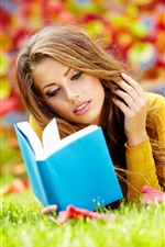 Preview iPhone wallpaper Brown hair girl, reading book, grass