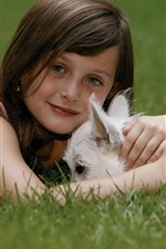 Preview iPhone wallpaper Cute little girl and white dog, grass