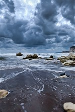 Preview iPhone wallpaper Dark clouds, coast, sea, rocks
