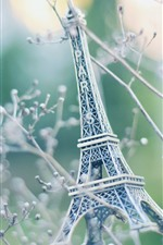 Preview iPhone wallpaper Eiffel Tower statue, toy, tree, twigs