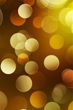 Abstratos círculos de luz amarela, brilhantes, brilham