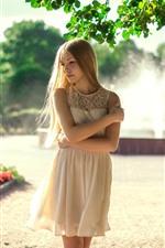 Blonde girl, fountain, white skirt, summer