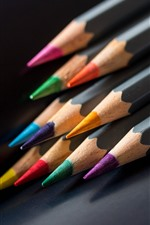 Colorful pencils, black background