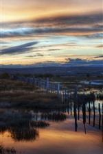 Preview iPhone wallpaper Fence, grass, swamp, dusk, clouds, sunset