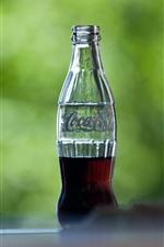 Preview iPhone wallpaper Half bottle of Coca-Cola