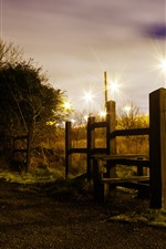 Preview iPhone wallpaper Wood fence, night, lights, trees, grass, path